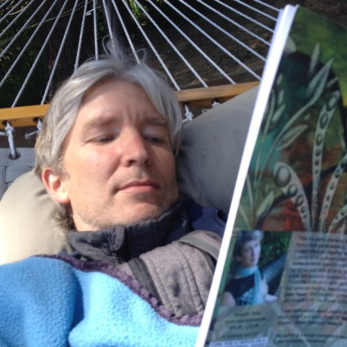 Mark reading Thrivability in the hammock